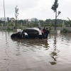하노이시: 갑자기 내린 집중 호우로 차량 침수.., 도로 배수 시스템 미비