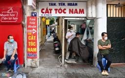 하노이시: 아침 일찍부터 손님들로 붐비는 이발소